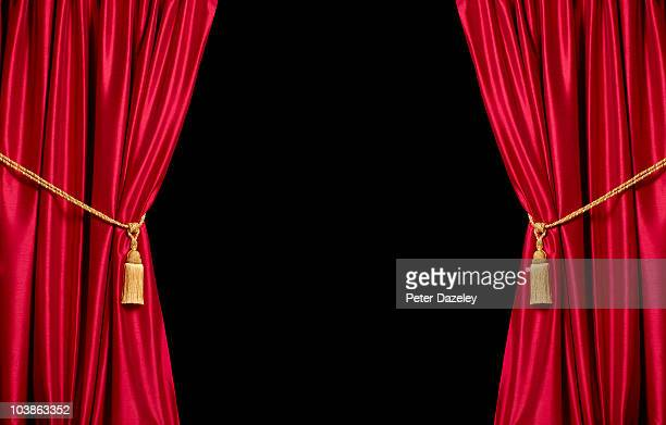 Red satin theatre curtains with black copy space