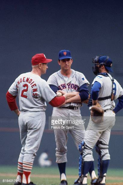 Red Schoendienst Jerry Koosman and Randy Hundley meet on mound during the All Star Game at Robert F Kennedy Stadium in Washington DC in 1969
