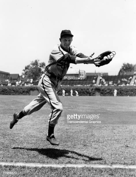 Red Schoendienst second baseman for the St Louis Cardinals flies through the air during warmups for a game with the Chicago Cubs at Wrigley Field in...