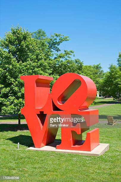 Red sculpture with word LOVE on grass