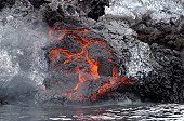 Red Sea, October 2, 2007 - Lava flows from the Yemeni island of Jazirat at-Tair after the island eru