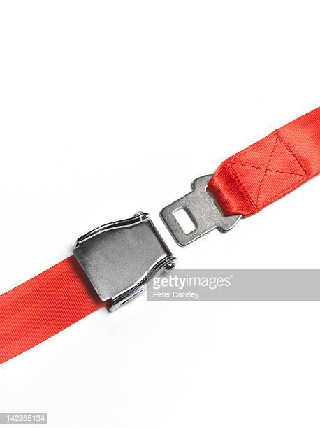 Red seat belt unfastened, straight
