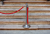 Red security rope across stone steps