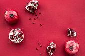 red set with cut pomegranate for restaurant menu top view mockup