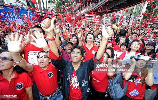 'Red Shirt' antigovernment protesters attend a rally seven months after a police crackdown on their antigovernment protest in Bangkok on December 19...