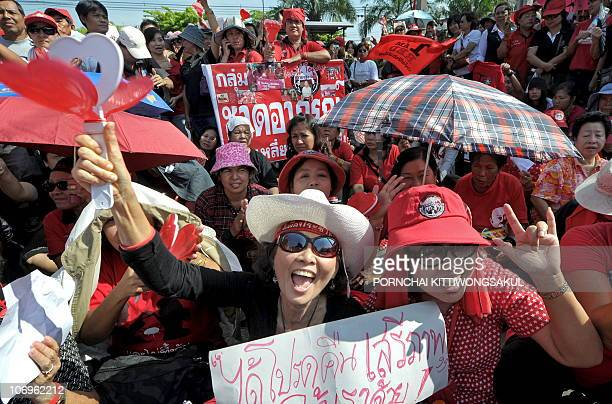 'Red Shirt' antigovernment protesters shout slogans during a demonstration in front of a Bangkok prison on November 19 2010 Thai 'Red Shirts'...