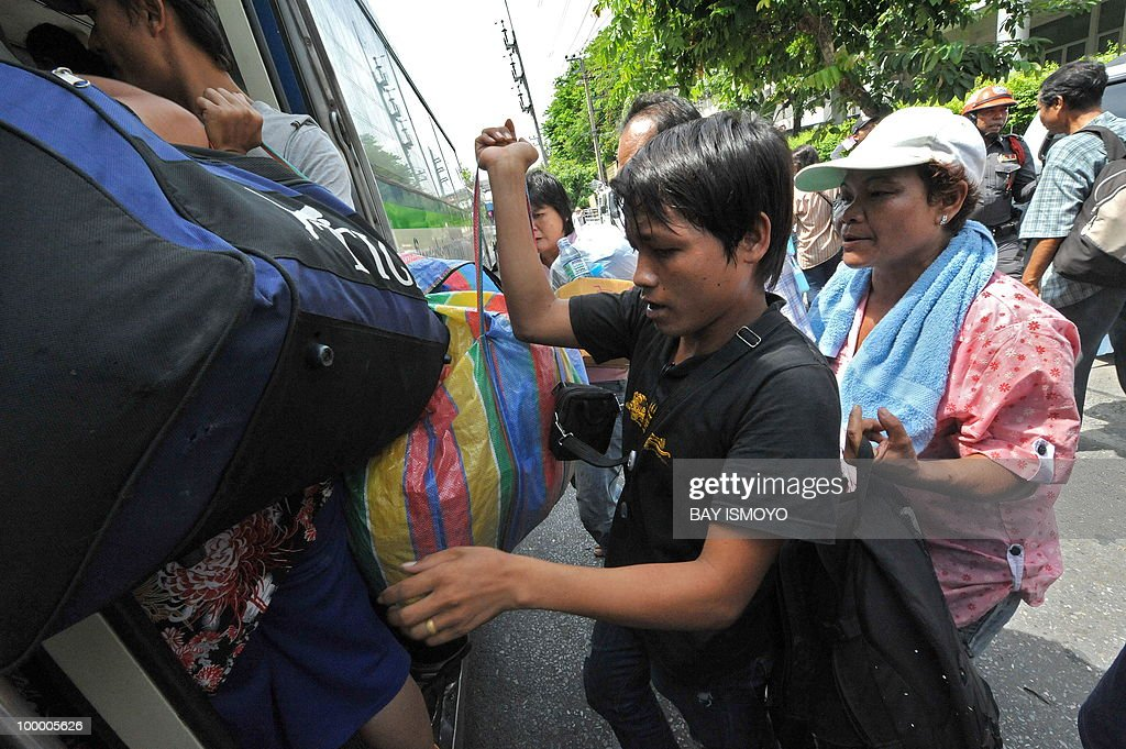 'Red Shirt' anti-government protestors board buses out of their dismantled protest site a day after an army assault, in downtown Bangkok on May 20, 2010. Plumes of smoke hung over the Thai capital and gunfire crackled As troops moved to crush militants who went on the rampage after a deadly crackdown on their anti-government protest camp.