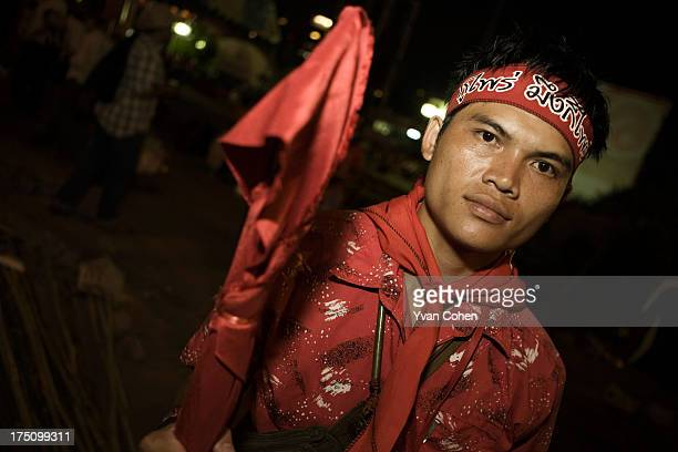 A red shirt protester manning his group's barricades opposite the commercial district of Silom Road in the heart of Bangkok The military moved into...