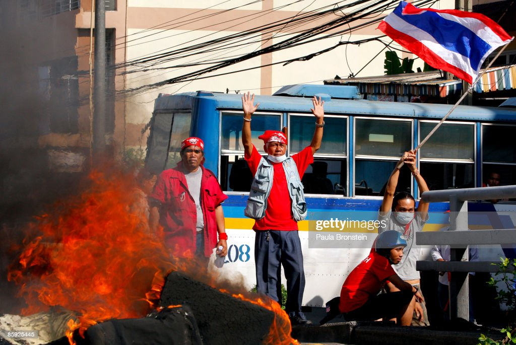 Red shirt protesters burn tyres during violent protests on April 13, 2009 in Bangkok, Thailand. Anti-government protesters clashed with the military on the streets of Thailand's capital after the government declared a state of emergency. The pro-Shinawatra demonstrators are calling for the resignation of Prime Minister Abhisit Vejjajiva and for fresh elections to be held.
