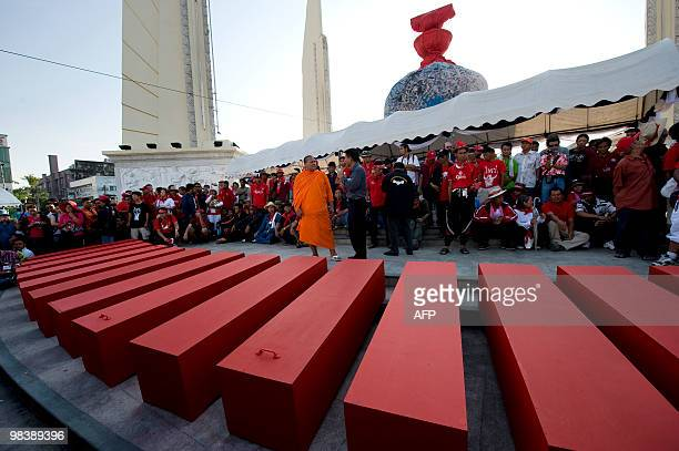 'Red Shirt' protesters stand next to red coffins at the Democracy Monument prepared for a memorial procession to remember comrades on April 11 2010...