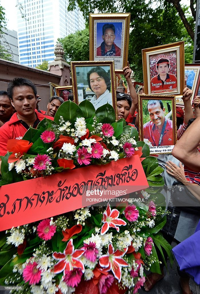 'Red Shirt' supporters hold portraits of protesters and journalists who died in 2010 unrest in the heart of the capital, as they mark the third anniversary of the military crackdown on anti-government protesters at a Buddhist temple in Bangkok on May 19, 2013. About 90 people were killed and nearly 1,900 wounded in a series of street clashes between demonstrators and security forces, which culminated in a military crackdown in May 2010. Two foreign journalists were among those killed.