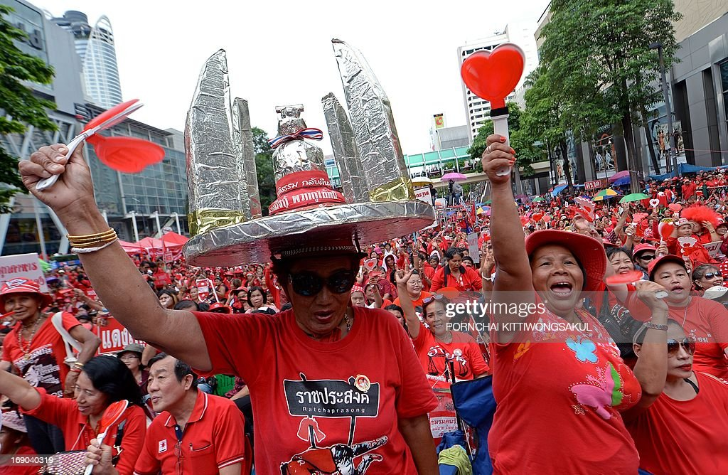 'Red Shirt' supporters shout slogans as they gather to mark the third anniversary of the military crackdown on anti-government protesters in Bangkok on May 19, 2013. About 90 people were killed and nearly 1,900 wounded in a series of street clashes between demonstrators and security forces, which culminated in a military crackdown in May 2010. Two foreign journalists were among those killed.