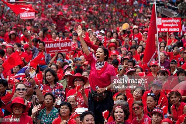 Red shirts cheer during a rally as tens of thousands gathered to commemorate the second anniversary of the violent government crackdown May 19 2012...