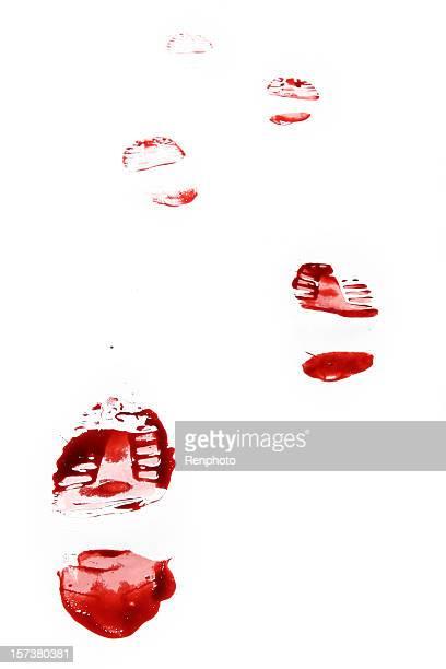 Huella de zapato rojo sobre fondo blanco