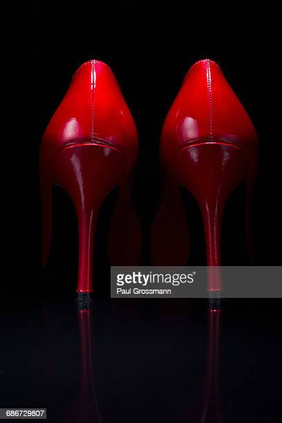 Red shoes against black background