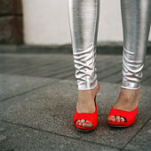 red shoes and silver trousers