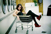 Red Shoes Black Dress Girl in Laundry Mat Cart