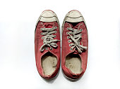 Red shoes is dirty on white background