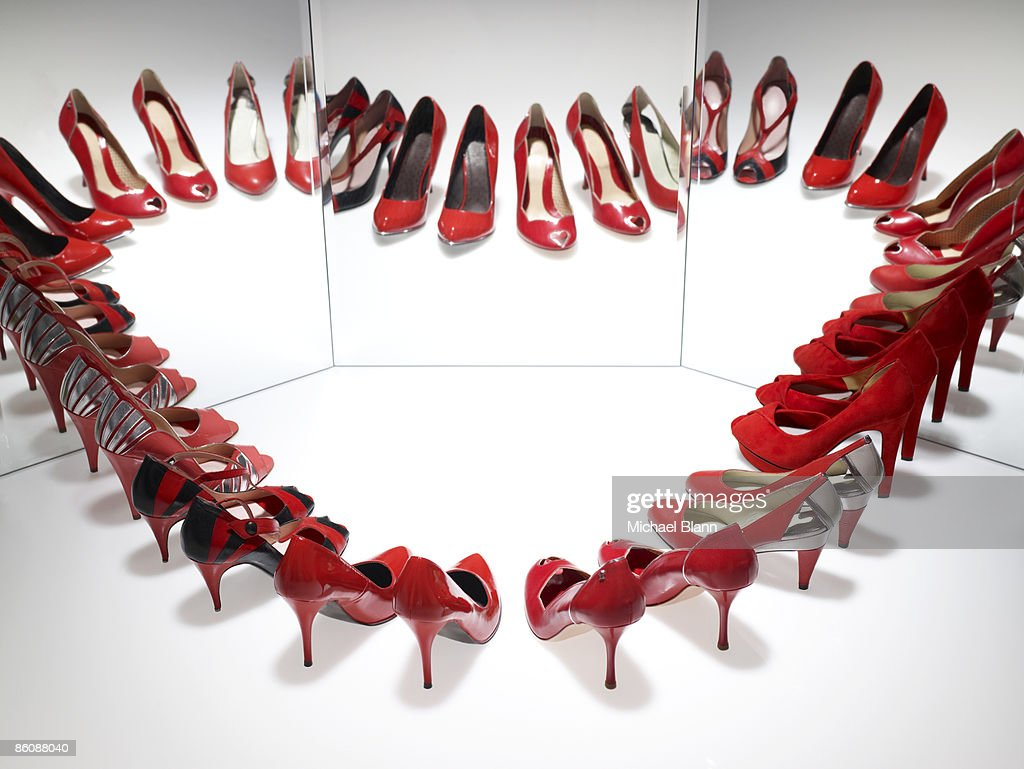 Red shoes reflected to form a heart : Stock Photo