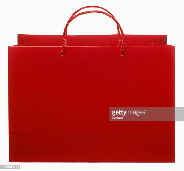 red shopping bag cut out on white