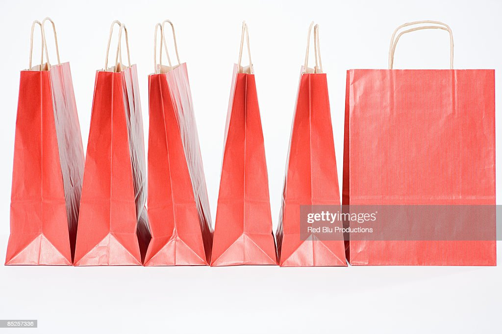 Red shopping bags in a row