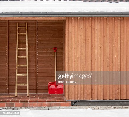 Red shovel and ladder : Stock Photo