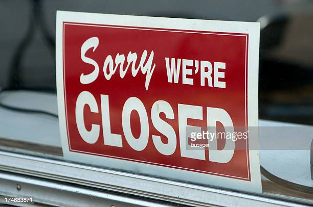 Red sign in window stating Sorry we're closed