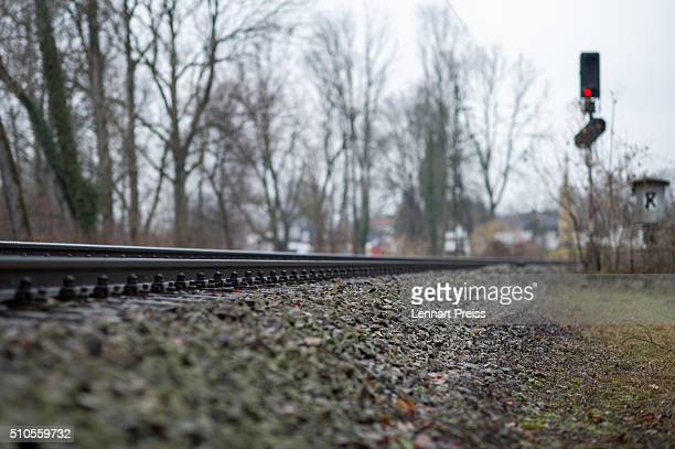 A red signal is seen at the train tracks near the site of last week's train crash that killed 11 and injured approximately 85 on February 16 2016...