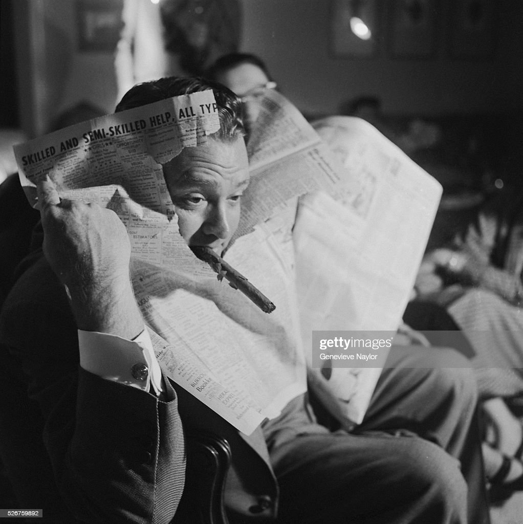 <a gi-track='captionPersonalityLinkClicked' href=/galleries/search?phrase=Red+Skelton&family=editorial&specificpeople=208234 ng-click='$event.stopPropagation()'>Red Skelton</a> pokes his head through the newspaper he was reading as he is captivated by a television show.