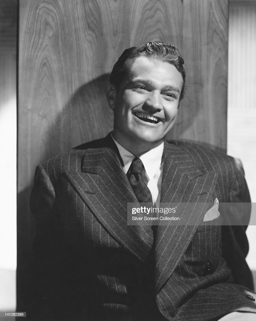 <a gi-track='captionPersonalityLinkClicked' href=/galleries/search?phrase=Red+Skelton&family=editorial&specificpeople=208234 ng-click='$event.stopPropagation()'>Red Skelton</a> (1913-1997), US comedian, wearing a pin stripe suit over a white shirt and dark tie, laughing in a studio portrait, circa 1950.