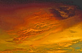 Red sky at dusk with approaching storm