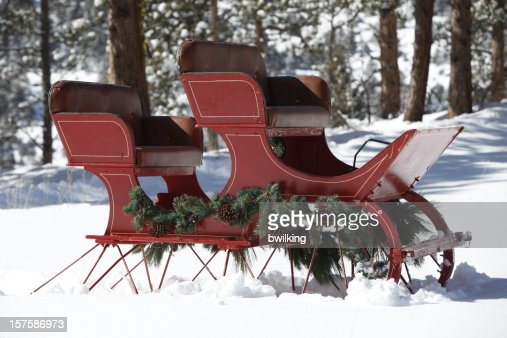 Red Sleigh in Snowy Mountain Woods