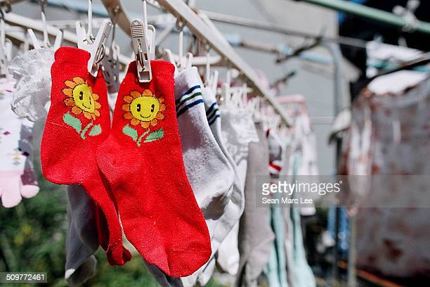 Red socks with cartoon sunflowers on them