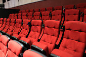 Red soft seats in the empty theatre