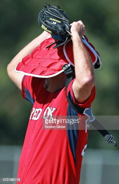 Red Sox catcher AJ Pierzynski removes his chest protector as he finishes a drill The Boston Red Sox held their first official spring training workout...