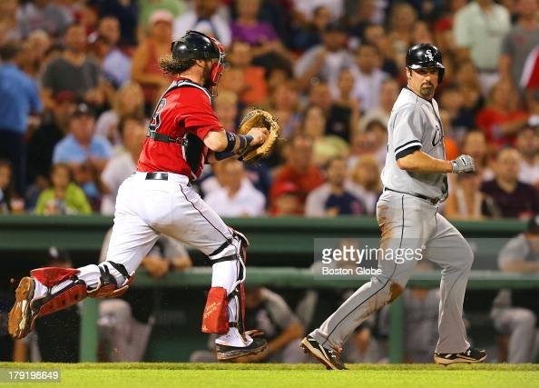 Red Sox catcher Jarrod Saltalamacchia gets White Sox player Paul Konerko caught in a rundown between home and third and tagged him out in the fifth...