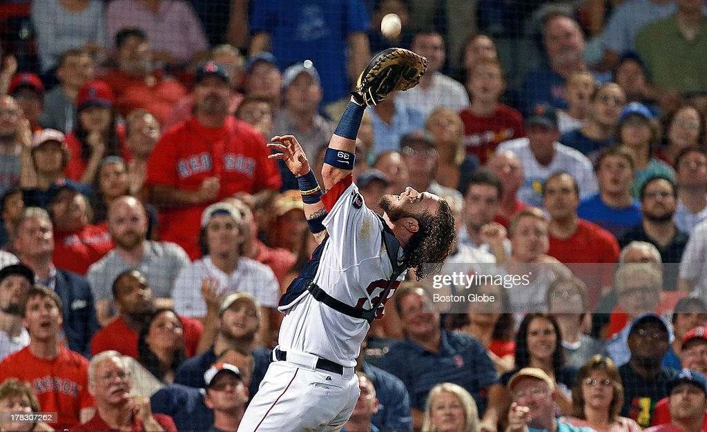 Red Sox catcher Jarrod Saltalamacchia makes the catch behind the plate on a foul ball hit by the Orioles' Nick Markakis to end the top of the sixth inning. The Boston Red Sox hosted the Baltimore Orioles in an MLB regular season game at Fenway Park.