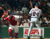 Red Sox catcher Jason Varitek loses his handle on one of Tim Wakefield's knucklers in the eight inning as Detroit's Karim Garcia watches
