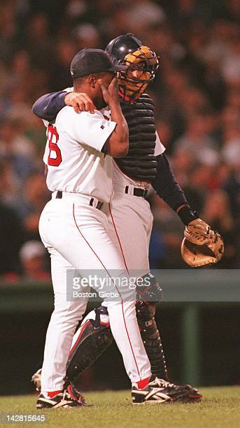 Red Sox catcher Jason Varitek talks with pitcher Tom Gordon who was brought in for relief with Yankees on base in the eighth inning Gordon worked the...