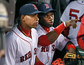 Red Sox center fielder Rusney Castillo made his Fenway Park debut tonight he is pictured as he looks for pointers from teammate and fellow Cuban...