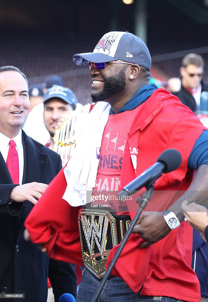 Red Sox designated hitter David Ortiz addresses the crowd at Fenway Park before the Red Sox players board the duck boats for the World Series victory parade for the Boston Red Sox on November 2, 2013 in Boston, Massachusetts.