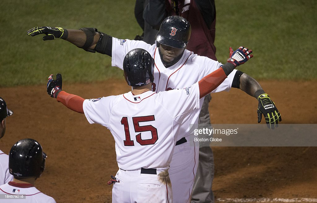 Red Sox designated hitter David Ortiz gets a hug from Dustin Pedroia after his eighth inning home run to tie the game. The Boston Red Sox hosted the Detroit Tigers in Game Two of the American League Championship Series at Fenway Park.