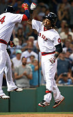 Red Sox designated hitter David Ortiz greets teammate Hanley Ramirez after he crossed the plate following his sixth inning home run his third round...
