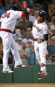 Red Sox designated hitter David Ortiz greets teammate Hanley Ramirez as he heads into the dugout following his third inning home run his second round...
