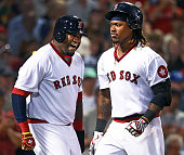 Red Sox designated hitter David Ortiz howls after he leapt as he greeted teammate Hanley Ramirez as he heads into the dugout following his third...