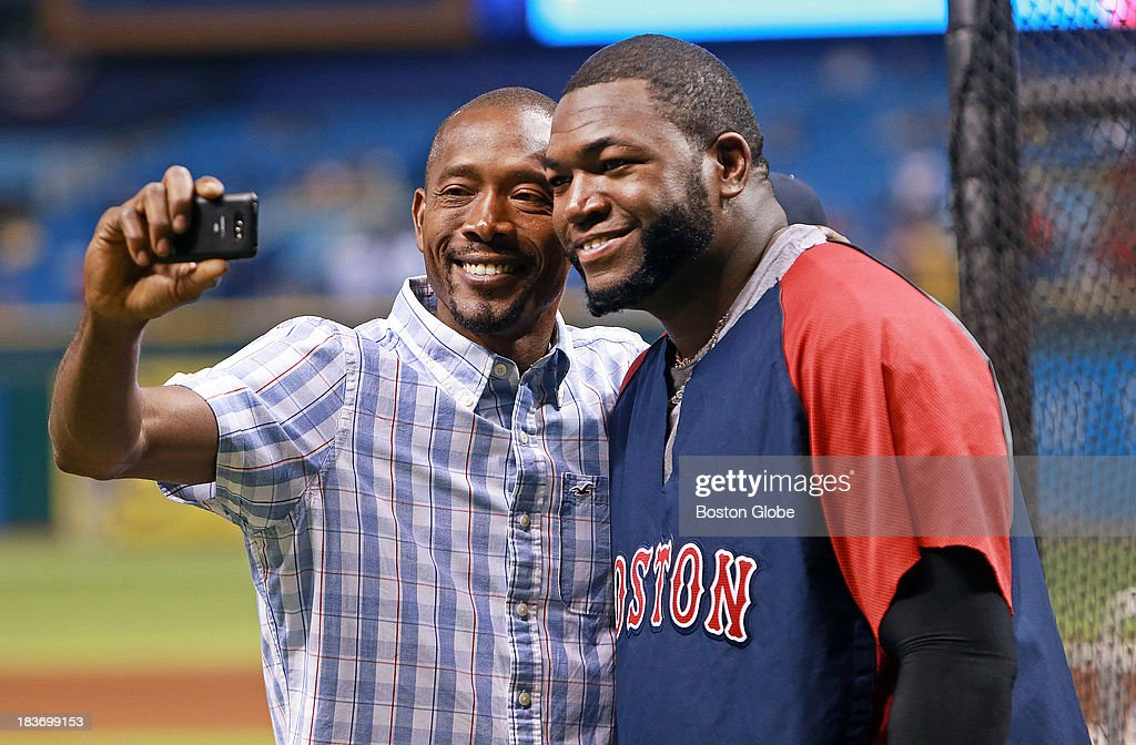 Red Sox designated hitter David Ortiz poses for a photo with a friend around the cage during batting practice. The Boston Red Sox visited the Tampa Bay Rays in Game Four of the ALDS baseball playoffs at Tropicana Field.