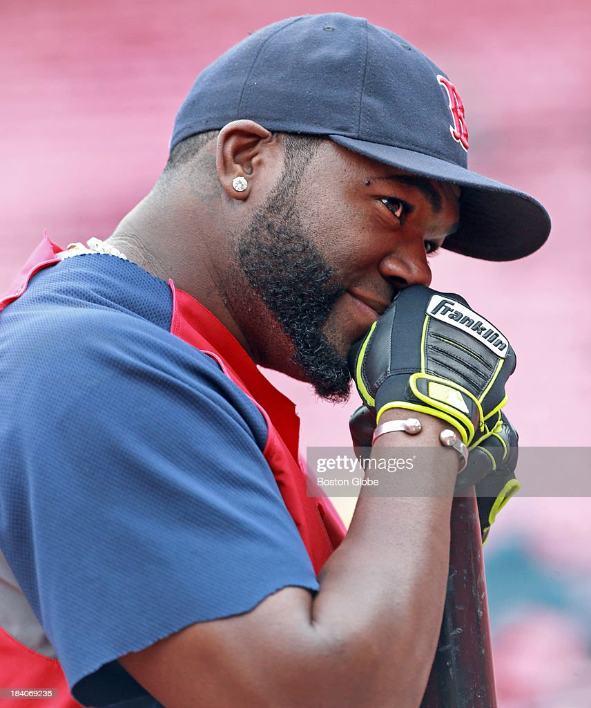 Red Sox designated hitter David Ortiz strikes a pensive pose as he chats with someone in the stands during batting practice. The Boston Red Sox had a workout at Fenway Park in preparation for Game One of the ALCS against either Oakland or Detroit.