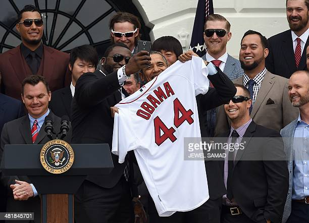 Red Sox Designated Hitter David Ortiz takes a selfie with US President Barack Obama after presenting his a jersey during a ceremony on the South Lawn...