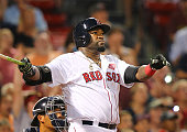 Red Sox designated hitter David Ortiz watches his eighth inning home run go into the stands The Boston Red Sox hosted the Minnesota Twins in a...