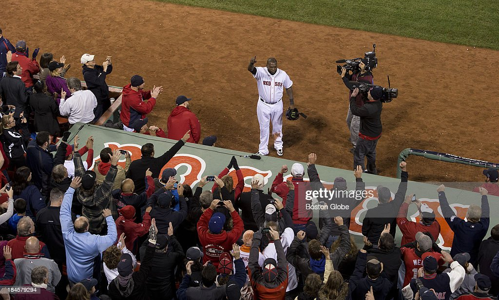 Red Sox designated hitter David Ortiz waves to the cheering crowd after his home run in the eighth inning to tie the game. The Boston Red Sox hosted the Detroit Tigers in Game Two of the American League Championship Series at Fenway Park.
